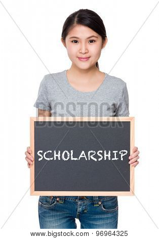 Woman hold with chalkboard and showing a word scholarship