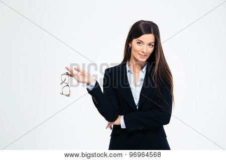 Happy businesswoman holding glasses isolated on a white background and looking at camera