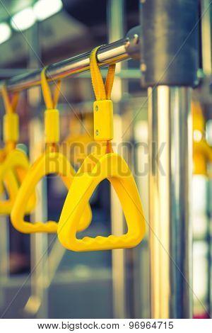 Handles passenger inside a bus.  ( Filtered image processed vintage effect. )