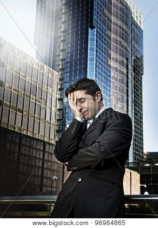 Young Tired And Worried Businessman Standing Outdoors In Stress