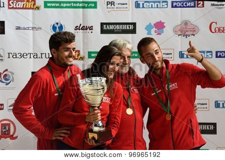 MOSCOW, RUSSIA - JULY 19, 2015: Team Spain with prizes during the Beach Tennis World Team Championship. Italy become world champion, Russia won silver, and Spain got bronze
