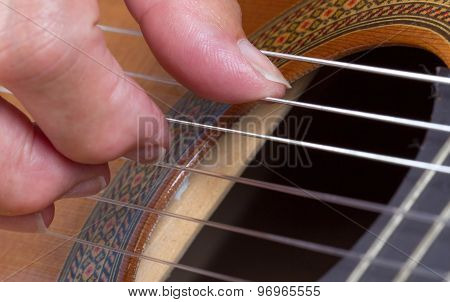 Old Woman's Hand Playing Guitar