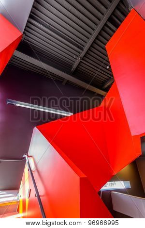Painted in red. Abstract fragment of the architecture of modern lobby, hallway of the luxury hotel, shopping mall, business center in Vancouver, Canada. Interior design.