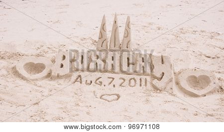 Sand castle on tropical white sand beach in Boracay Philippines