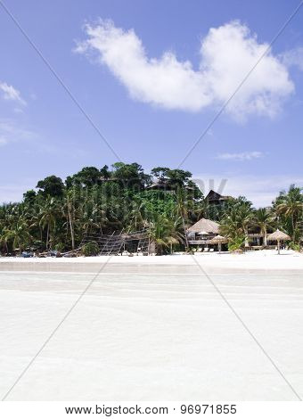 palm tree white sand and turquoise sea water Philippines Boracay