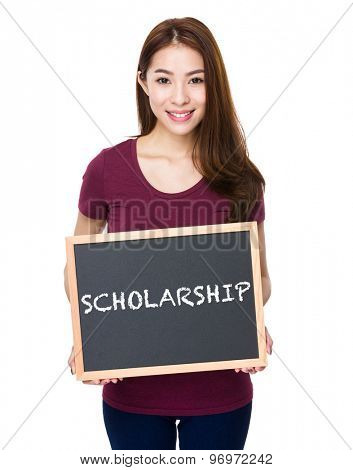 Young woman show with chalkboard a word scholarship