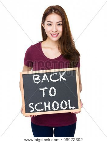 Young woman show with chalkboard phrase of back to school
