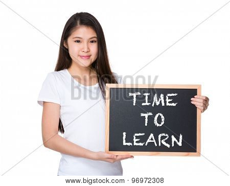 Young lady with black board and showing phrase time to learn