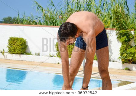 Man Streaching By The Pool