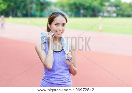 Young woman after running in sport stadium