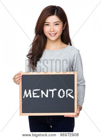 School girl hold with chalkboard and showing a word mentor