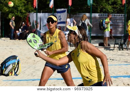 MOSCOW, RUSSIA - JULY 17, 2015: Samantha Barijan (in front) and Joana Cortez of Brazil in the quarterfinal match of the Beach Tennis World Team Championship against France. Brazil won the match