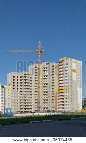 Tower Crane On The Construction Of A New High Multistory Apartment House