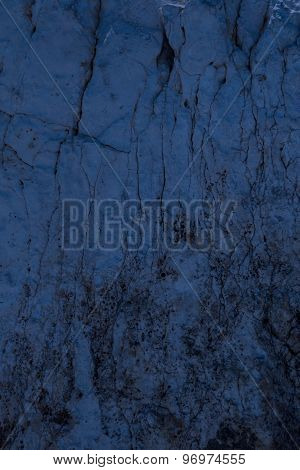 Blue night cracked stone background