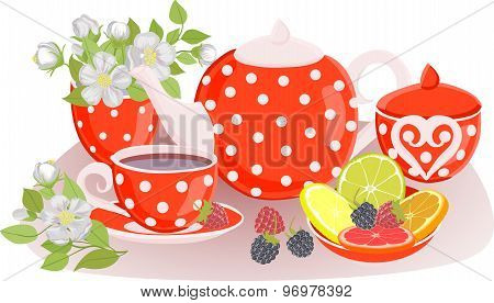 The composition of the kettle, cups, flowers, citrus and berries on the table.