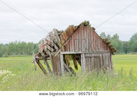 Tumbledown Barn standing On A Field