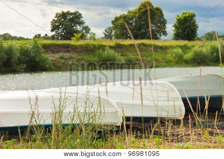 Boats On The River Bank