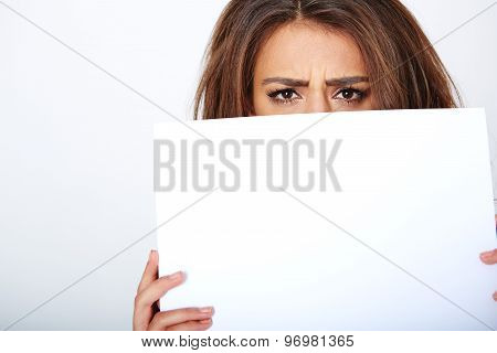 Banner sign woman peeking over edge of blank empty paper