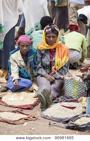 OROMIA, ETHIOPIA-APRIL 22, 2015: Unidentified woman and her daughter sell grain and eggs in an outdoor market in Ethiopia