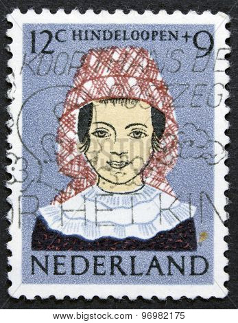 Women on a postage stamp.