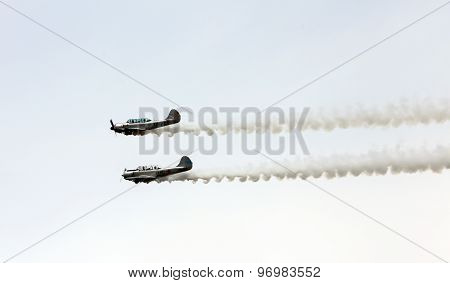 Thiene, Vicenza - Italy. 26Th July, 2015:two Aircraft Perform Amazing Aerobatics With Smoke