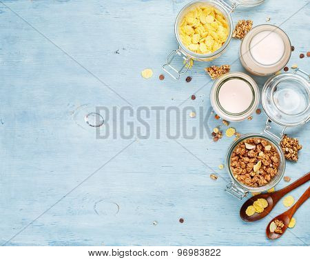 Yogurt with muesli and cornflakes.
