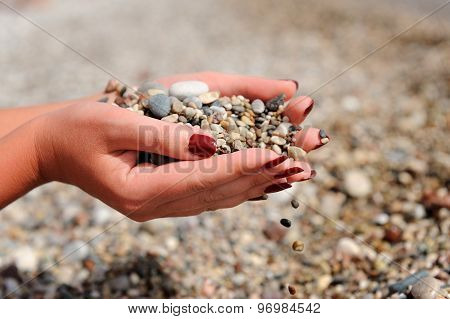 Hands Dropping Small Stones