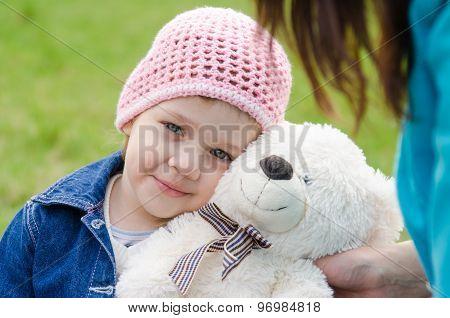 Tired Girl Lay On A Teddy Bear