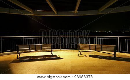 Park benches with spot light at night