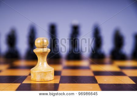 Concept With Chess Pieces On A Wooden Chess Board
