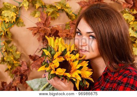 Cute Young Woman Smelling The Sunflowers