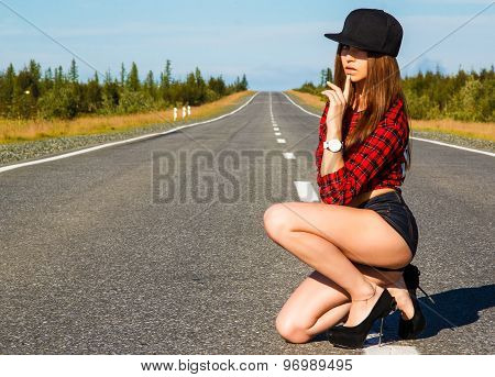 Sexy Woman In A Checked Shirt On The Road