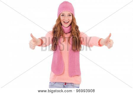 Cute smiling girl wearing scarf and cap isolated on white