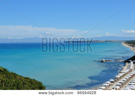 Panoramic View Of A Long White Sand Beach Beside The Turquoise Sea And Transparent Mediterranean Sea