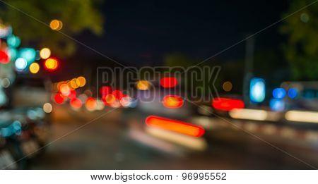 Unfocused Light Of Traffic In A Street
