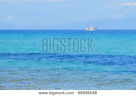 Fishing Boat On The Beautiful Turquoise And Clear Waters Of The Mediterranean Sea