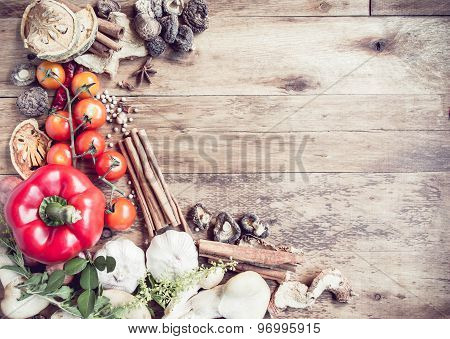 Fresh Organic Vegetables And Spices On A Wooden Background.