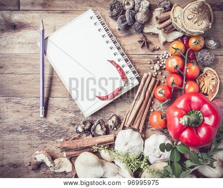Fresh Organic Vegetables And Spices On A Wooden Background And Paper For Notes. Open Notebook And Pe