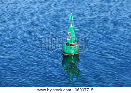 Green Modern Navigation Buoy On Sea Water