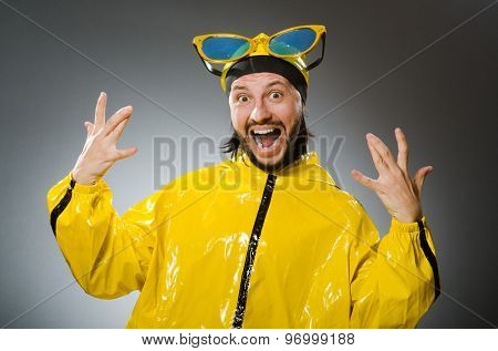 Man wearing yellow suit in funny concept