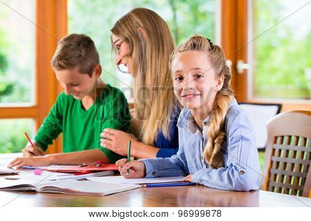 Private teacher giving lessons at home, books are on the table