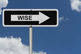 foto of wise  - The way to being wise Black and white street sign with word Wise with sky background - JPG