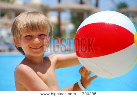 Boy With Ball At Pool