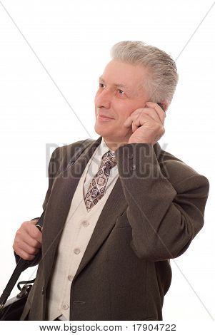Older Man Talking On A Mobile Phone Against White Background.