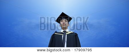 Asian male graduate with angel wings