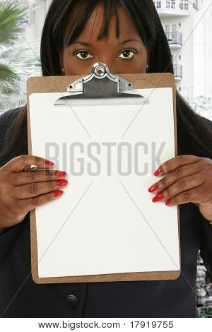 Woman With Blank Clipboard At Hotel Lobby