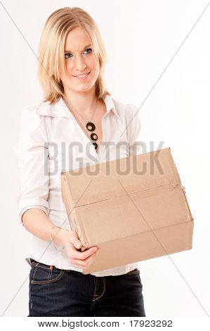 Blonde young  woman holding a cardboard package