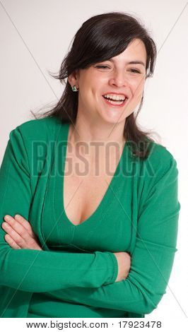 Portrait of a laughing brunette dressed in green