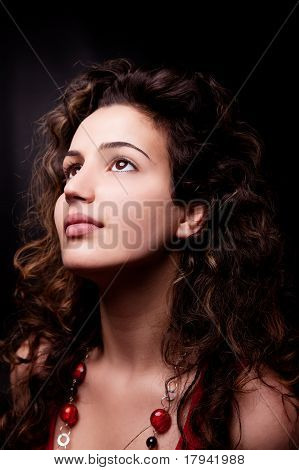 Young And Attractive Woman Looking Up Smiling, Isolated On Black, Studio Shot