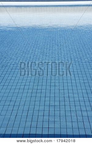 Blue tiles pool  water waves perspective summer background